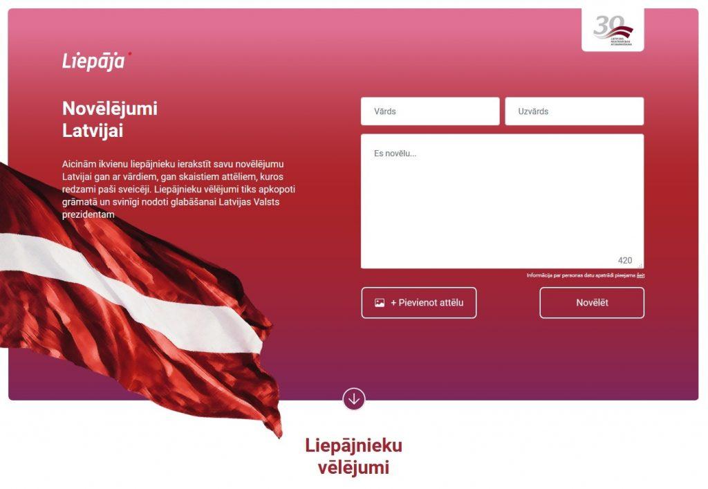 Latvijas valsts svētku makets par godu 4. maijam, kurā ir aicinājums raksīt novēlējumus Latvijai